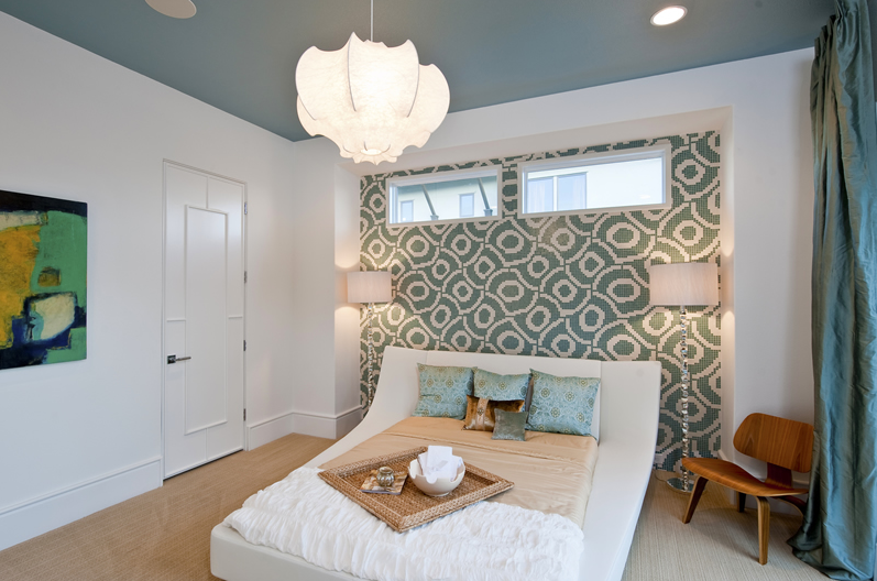 bedroom-with-beautiful-pendant-lamp-and-blue-wall-feature